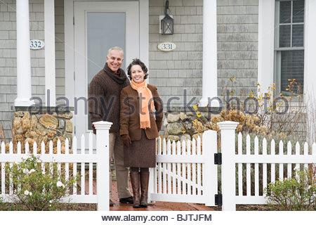 Mature couple outside house - Stock Photo