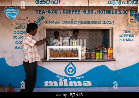 India, Kerala, Palakkad, samosas, cutlets, Vadai and soft drinks on display at roadside Milma snack stall - Stock Photo