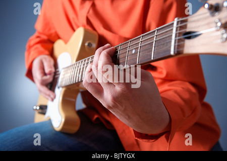 closeup of hands of a musician playing electric guitar - Stock Photo