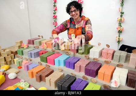 Natural soaps. Saleswoman in a stall. Fira Natura. Lleida. Catalonia, Spain. - Stock Photo