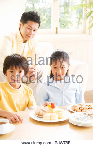 Happy family relaxing in their living room - Stock Photo