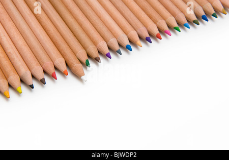 Line of Colouring Pencils on a White background With One White Pencil Standing Out - Stock Photo