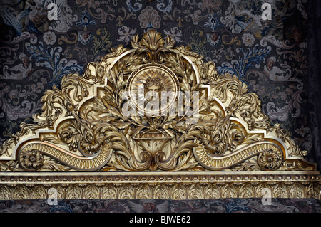 Gilt/gold Headboard of bed in Mercury Salon (Drawing Room), The King's Apartments, Versailles. Image of the Sun - Stock Photo
