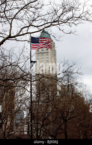 American Flag in front of Building on 5th and Broadway New York, United States of America - Stock Photo