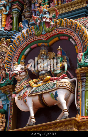 India, Tamil Nadu, Madurai, Sri Meenakshi Temple, west gopuram, Krishna and consort Radha on Nandi bull - Stock Photo