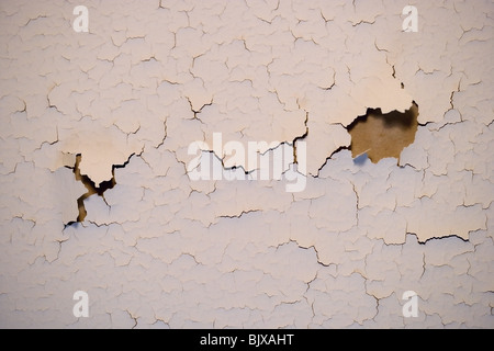 Paint cracking on an interior wall of a house. - Stock Photo