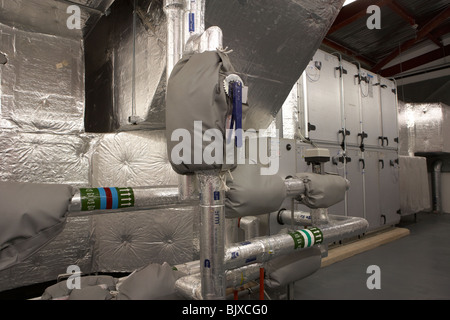 insulated pipework of new installation hvac heating ventilation and air conditioning system in a modern office building