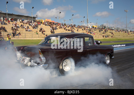 Classic 1960s Australian Holden EK modified to be a high powered V8 drag racing car - Stock Photo