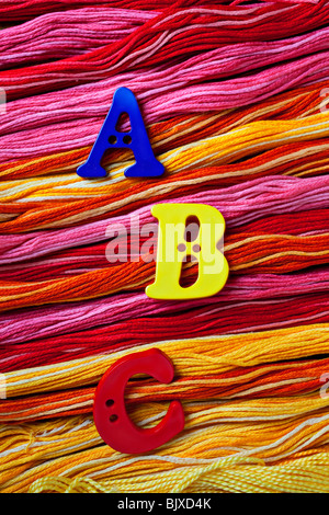 A B C buttons on thread - Stock Photo