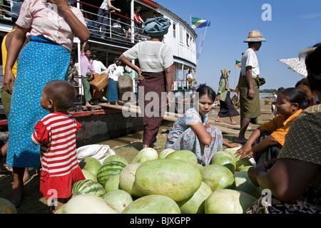 Women selling watermelons. Pakokku jetty. Boat stopover on the route Mandalay-Bagan. Myanmar - Stock Photo