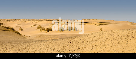 Panoramic shot of landscape showing wind erosion in the Valley of The Whales, Wadi El-Hitan, Western Desert of Egypt - Stock Photo