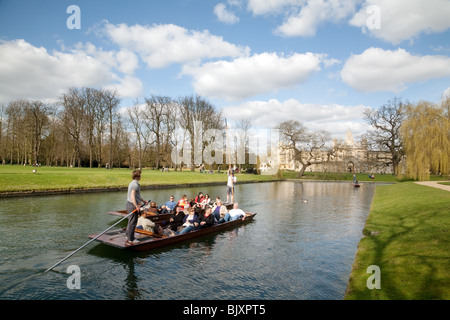 Punting on the River cam on the backs between Trinity and St Johns College, Cambridge, UK - Stock Photo