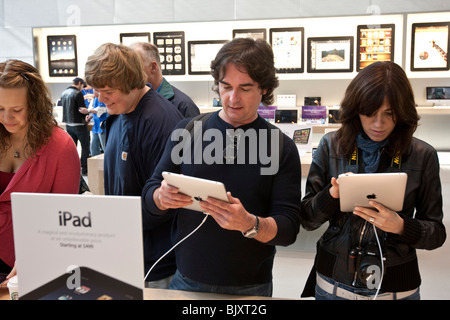 People try out the Apple iPad at the UWS Apple store in New York, USA, 3 April 2010. - Stock Photo