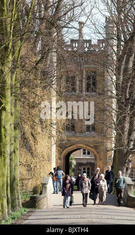 Tourists crossing the bridge, Trinity College, Cambridge University, Cambridge, UK - Stock Photo