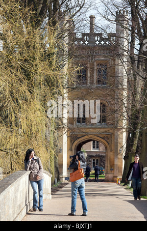 Tourists taking photos on the bridge across the river cam, Trinity College, Cambridge University, Cambridge, UK - Stock Photo