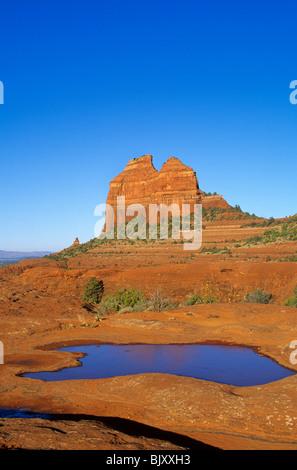 Waterpocket in sandstone at Teapot Rock, Bear Wallow Canyon, Coconino National Forest, Sedona, Arizona, USA - Stock Photo