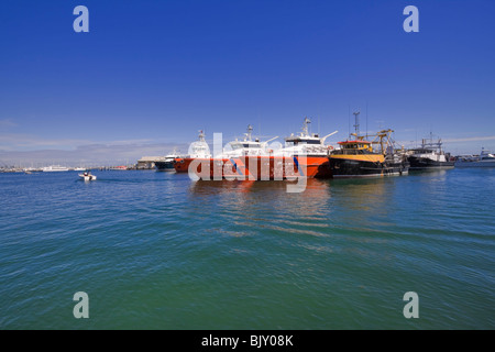 Offshore Oil Rig Service boats in Fremantle Harbour, Western Australia. Supply vessels at anchor in Fremantle port. - Stock Photo