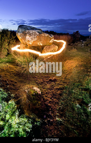 Ring of fire around Druid's Altar overlooking the Whitepark bay on the Antrim coast, Northern Ireland. - Stock Photo