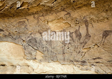 Rock art in the Cave of the Archers near cave of Swimmers, Wadi Sura area of Gilf Kebir region of Egypt's Western - Stock Photo
