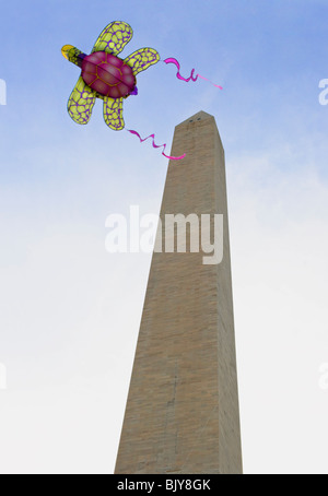 A kite flying on the Washington Monument grounds on the National Mall, Washington D.C.  during the National Kite - Stock Photo