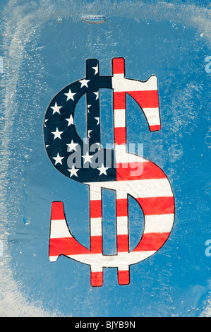 Stars and stripe dollar sign encased in ice with blue background - Stock Photo