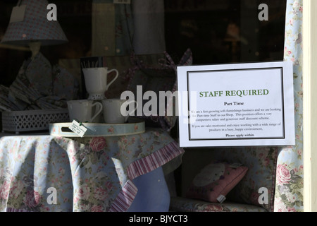 Notice in a shop window reading Staff Required Part Time - Stock Photo