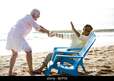 Senior couple having fun spending time at the beach - Stock Photo