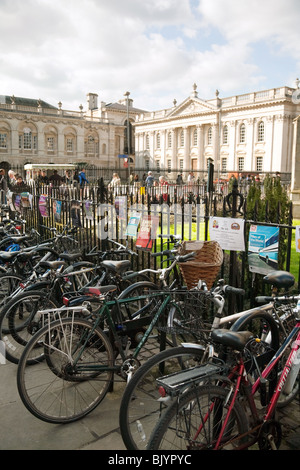 Bicycles parked on Kings Parade, The Senate House in the background, Cambridge, UK - Stock Photo