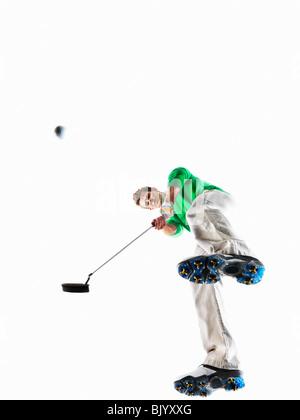 Man playing golf shot - Stock Photo