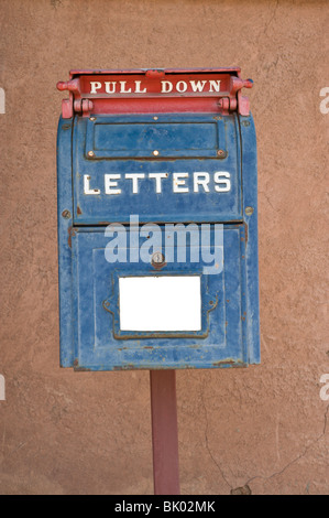An old-fashioned red, white and blue mail box is still ready to accept out-going letters posted in Lincoln, New - Stock Photo