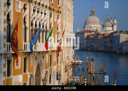 View of hotels and the Santa Maria della Salute church, from the Accademia bridge, Venice, Italy - Stock Photo