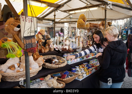 Women shopping in the market, the Market Square, Cambridge, UK - Stock Photo