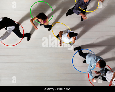Men and women with hula hoops - Stock Photo
