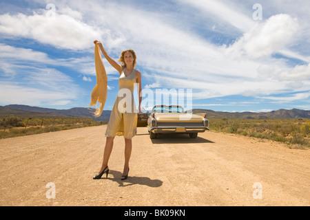 Helpless woman in desert - Stock Photo