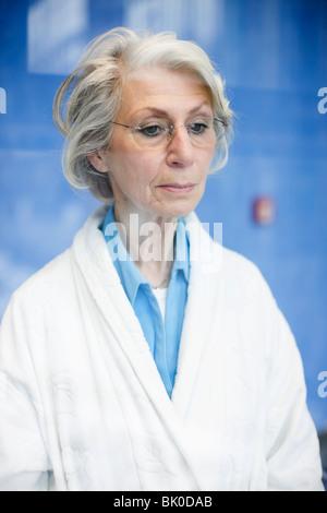 Sad old woman - Stock Photo
