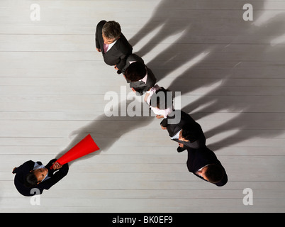 Business woman shouting at colleges - Stock Photo