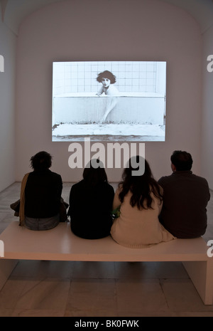 Visitors watching a Buster Keaton movie in the Centro de Arte Reina Sofia, Madrid, Spain - Stock Photo
