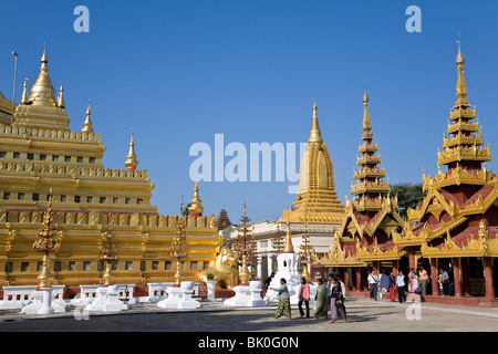 Burmese devotees at Shwezigon Paya. Nyaung U. Bagan. Myanmar - Stock Photo