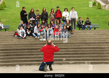 School group of teenagers posing for group shot on steps of Sacre Coeur Paris - Stock Photo