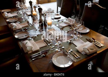 Dining room at the luxury wilderness resort Treetops near Rotorua New Zealand - Stock Photo