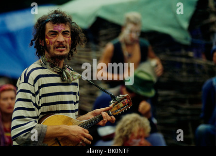 Middle-aged man with his face painted as a tiger and his ...