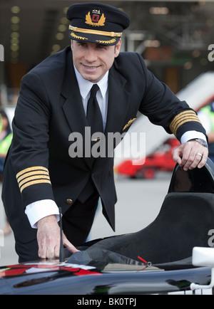 John Travolta in his Qantas Pilots Uniform - Stock Photo