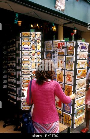French woman, young woman, tourist, buying postcards, postcard rack, Place du Tertre, Montmartre District, Paris, - Stock Photo