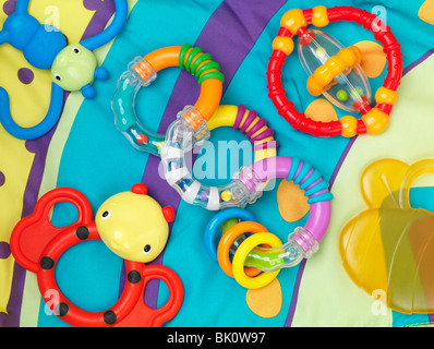 Colorful baby toys isolated on white background - Stock Photo