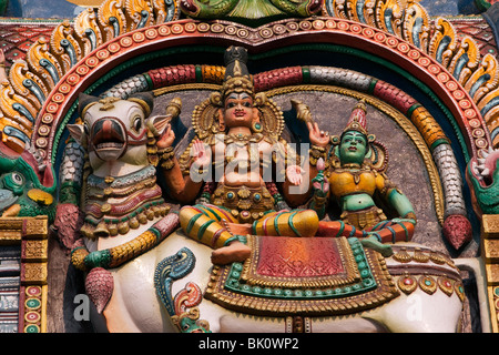 India, Tamil Nadu, Madurai, Sri Meenakshi Temple, newly restored west gopuram, shiva and parvati on nandi bull - Stock Photo