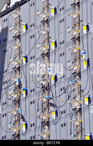 Cables and connectors on the back of a big outdoor TV screen - Stock Photo