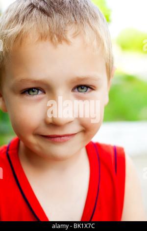 Smile of serene cute beautiful kid - Stock Photo