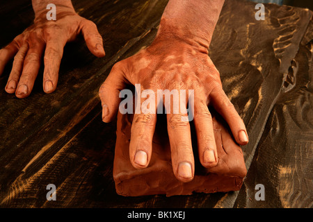 pottery craftsmanship potter craftsman hands working red clay - Stock Photo