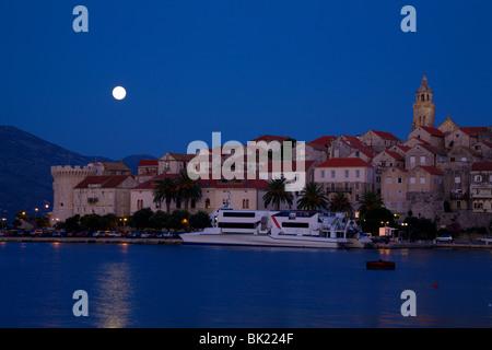 Korcula, Croatia with rising full moon - Stock Photo