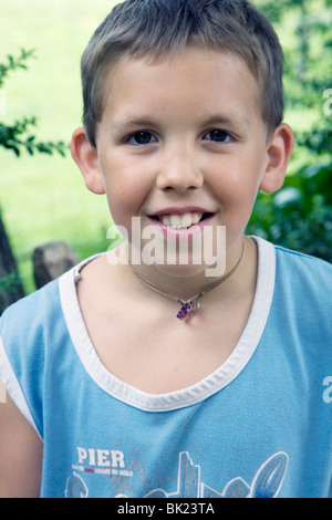 My son Ricky, a 10 year old Caucasian male, summertime, relaxing at home, school vacation, happy and at ease, steady - Stock Photo